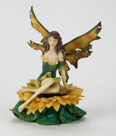 Fairy Sitting on Sunflowers